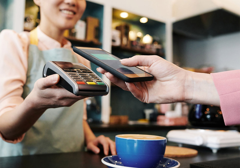 Woman paying with digital wallet